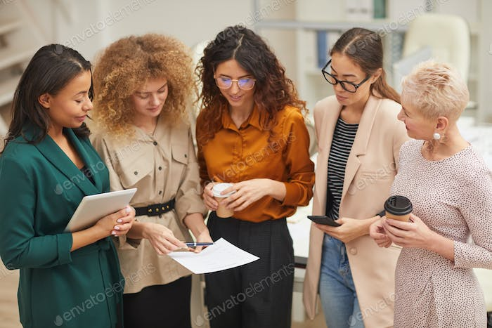 Workaholic Women Talking During Break