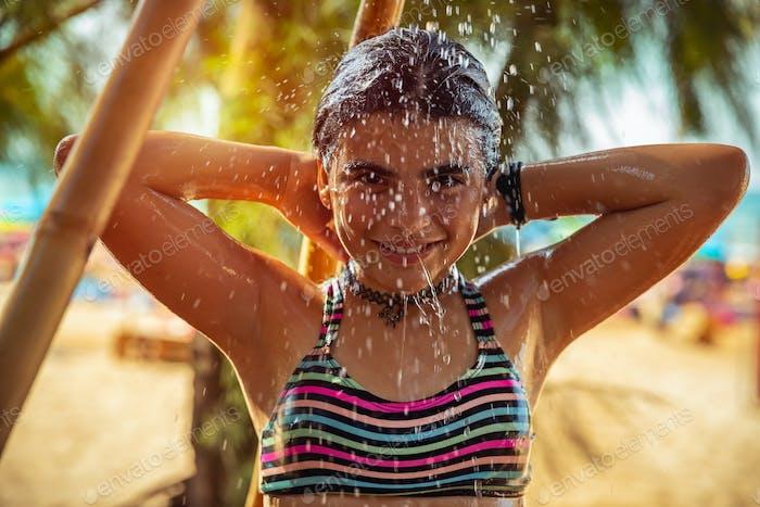 Little girl on the beach resort