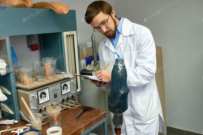 Prosthetist Taking Notes at Work
