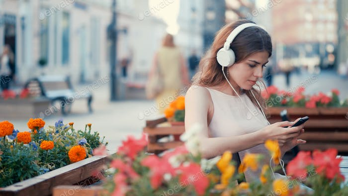 Young attractive girl listen to music