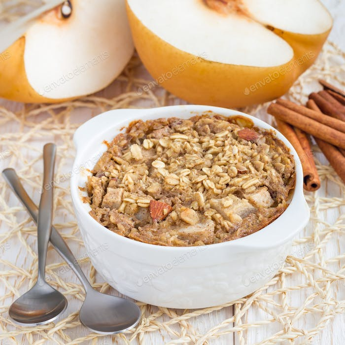 Baked oatmeal with nuts, almond milk, honey, spices and pear, square