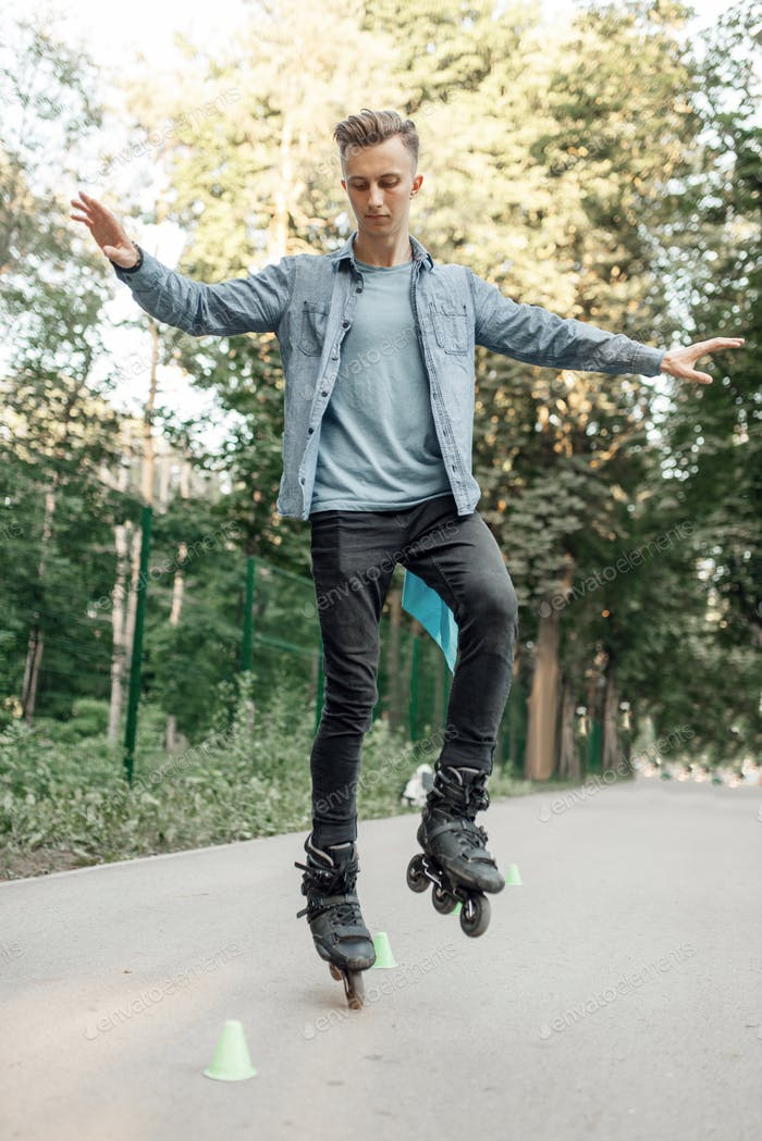 Roller skating, male teenager rolling on one leg