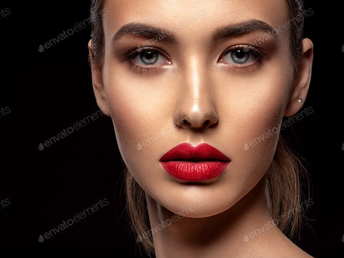 Beautiful  fashion woman with red lipstick. Pretty model.