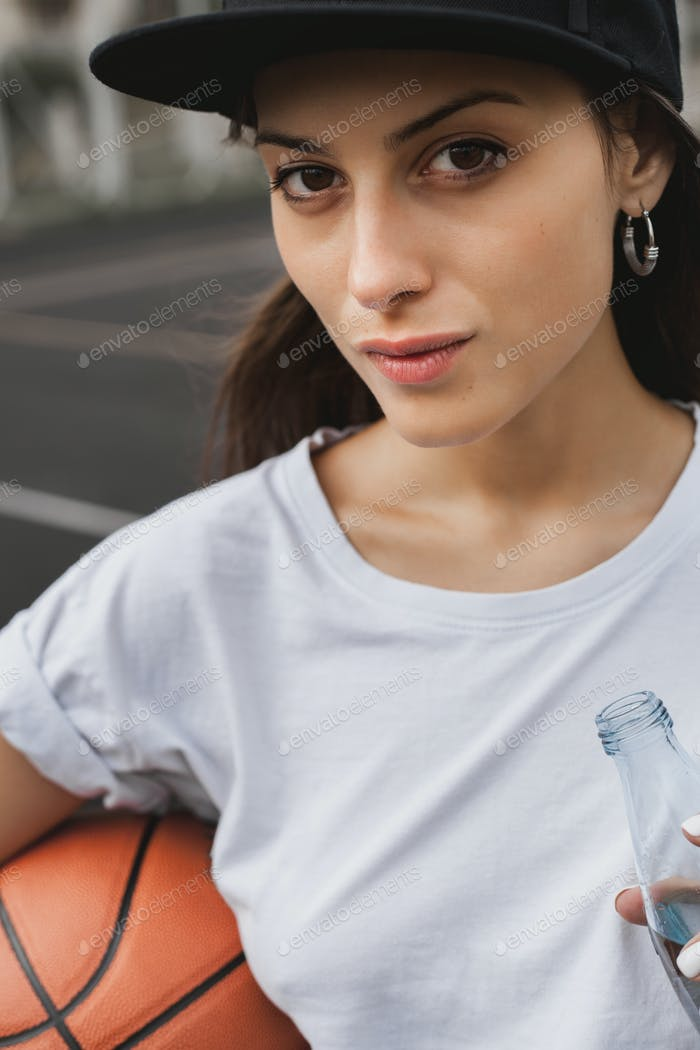 Sporty girl with basketball