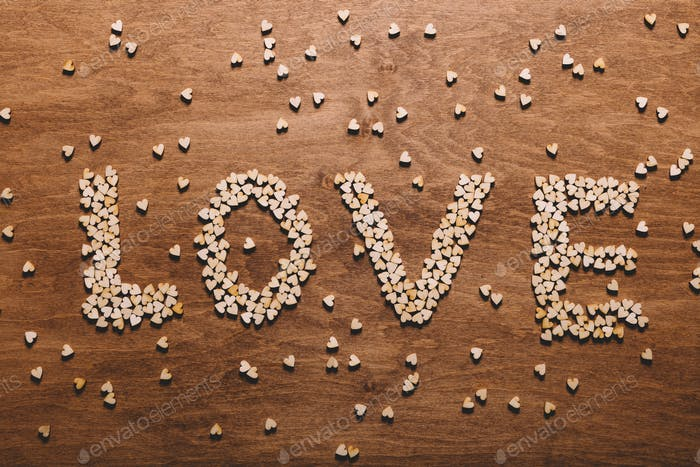 """Love"" writing made from little hearts."