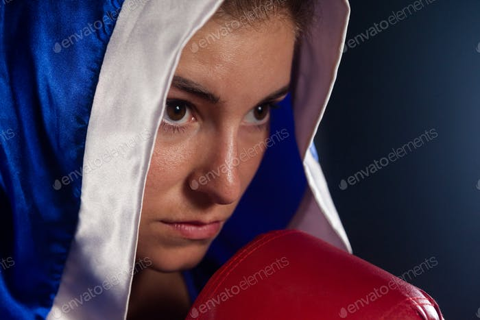 Determined woman wearing boxing robe