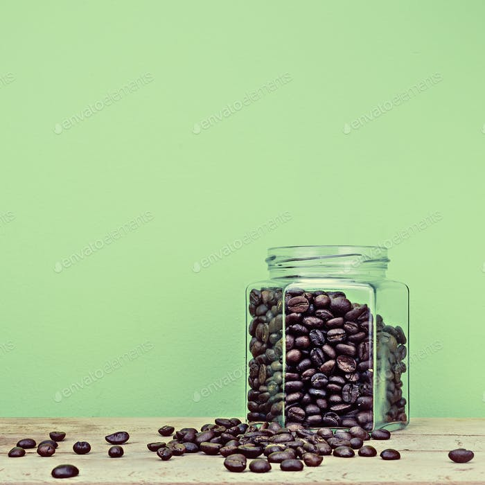 Coffee on green background on wooden surface