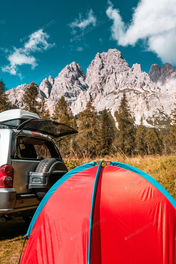 Tent in Mountains. Road trip and Outdoor Adventure Activity