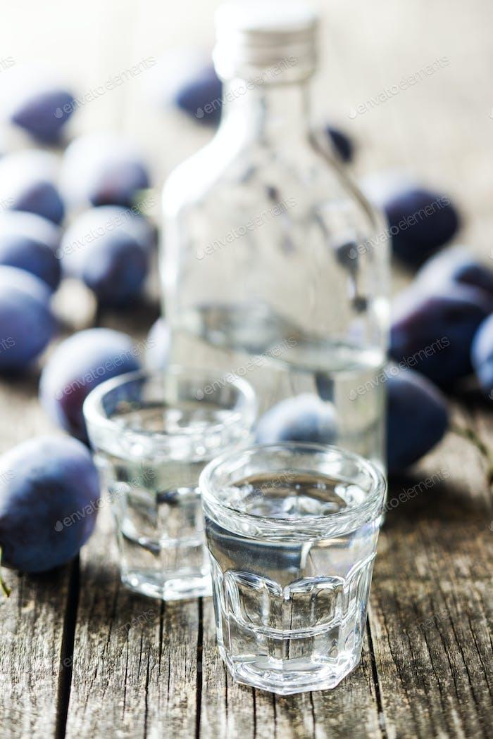 Plum brandy and plums.