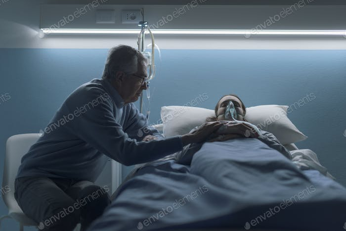 Senior man assisting her daughter at the hospital