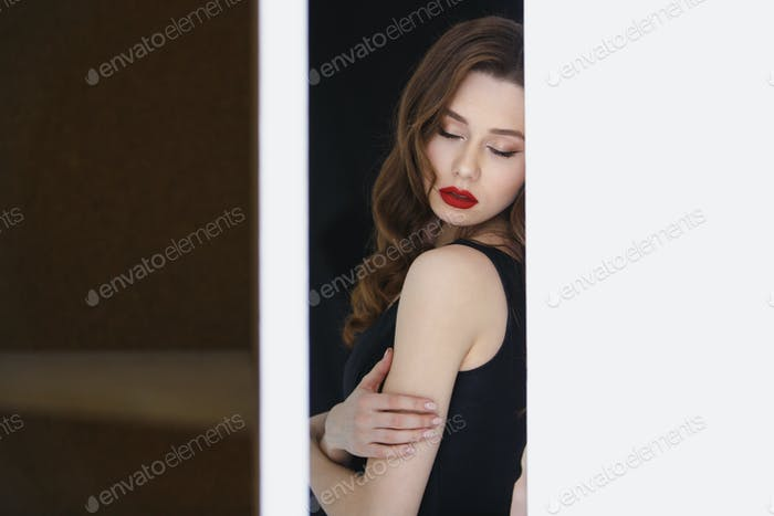 Sensual woman with red lips and closed eyes