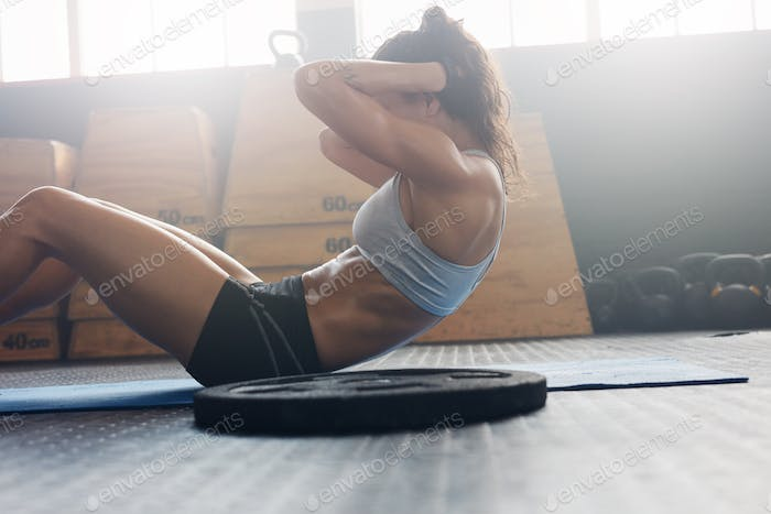 Fitness woman exercising to improve core muscle strength