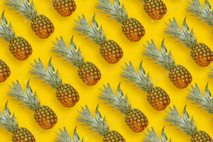 Many pineapples on bright yellow paper background