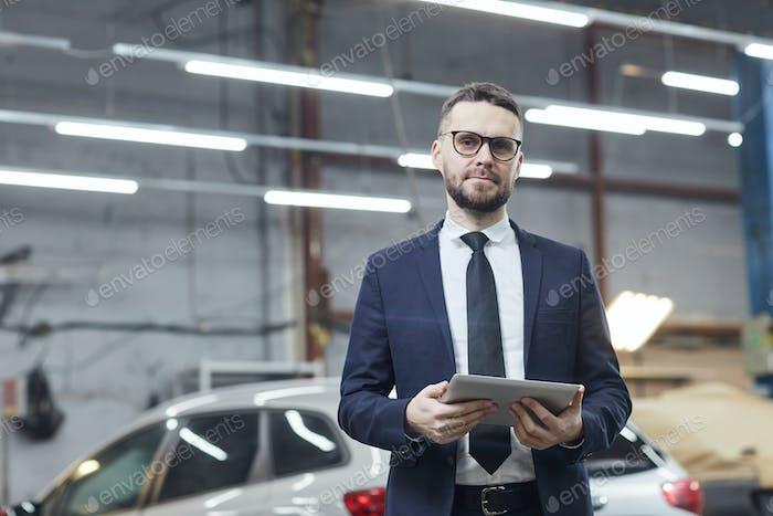 Modern Businessman In Auto Service Center
