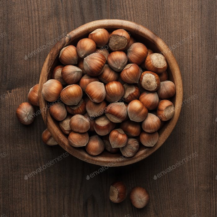 Hazelnuts In Wooden Bowl On The Brown Table
