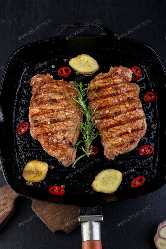 Grilled pork steak in grill pan