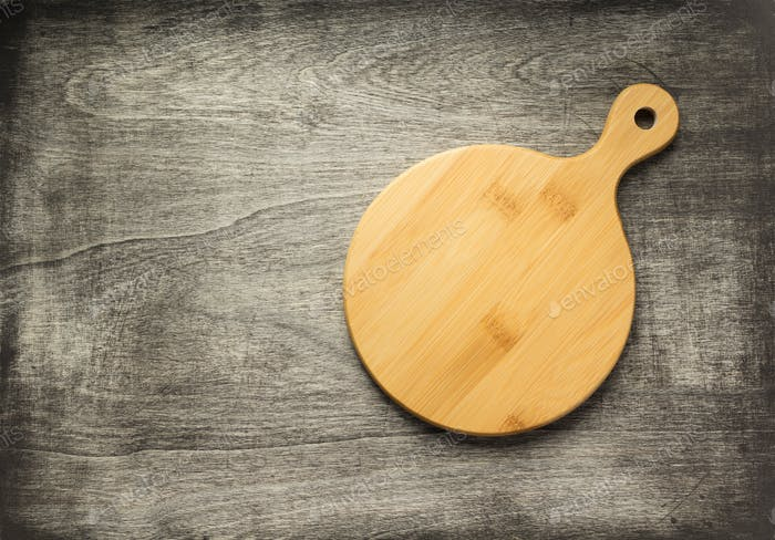 cutting board at old wooden table