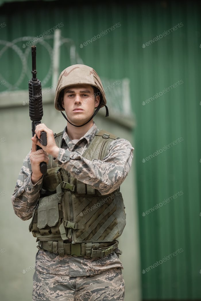 Military soldier standing with a rile