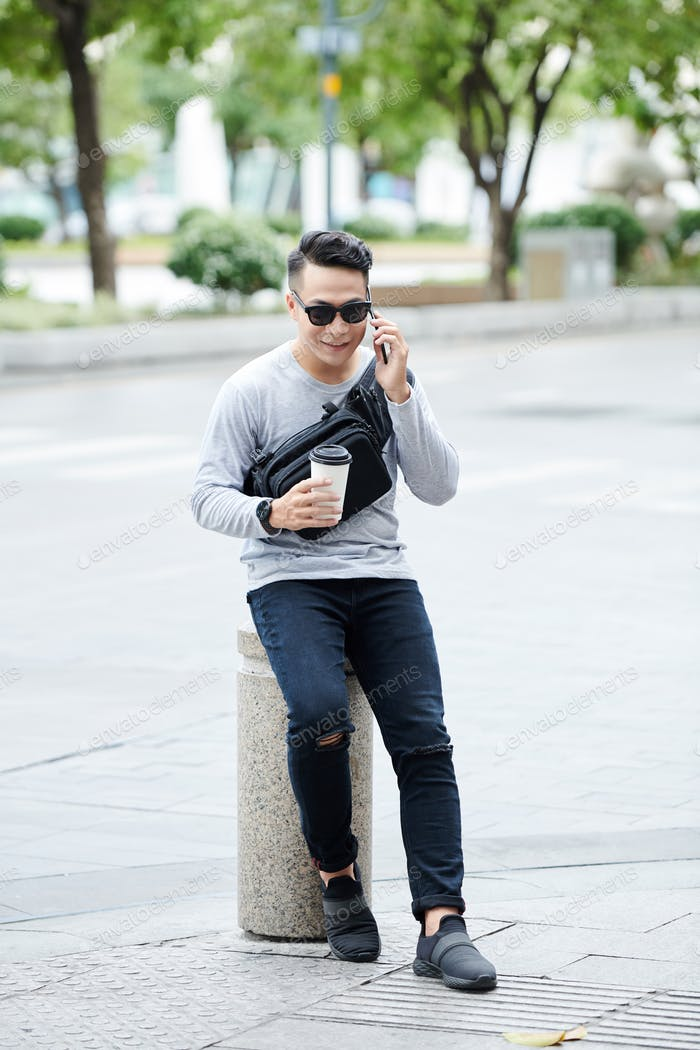 Asian Man Talking by Phone Outdoors