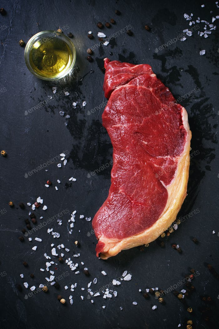 Raw steak with olive oil