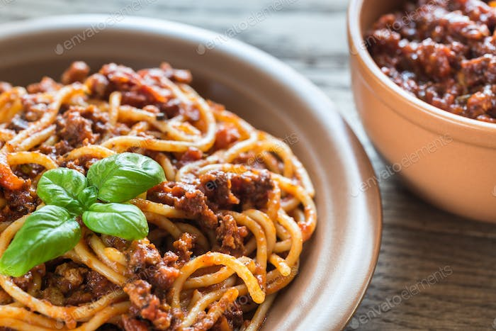 Spaghetti with bolognese sauce on the wooden background