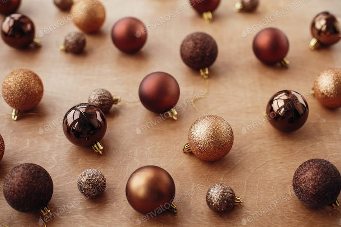Christmas golden glitter baubles and balls on rustic background