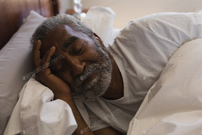 Close-up of senior African American man sleeping in bedroom at home