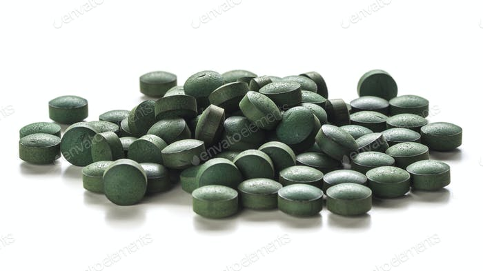 Spirulina Tablets Over White Background