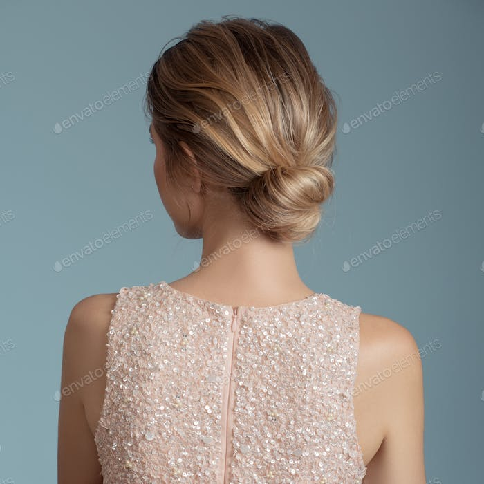 Portrait Of Blonde Woman. Hairstyle. Rear View.