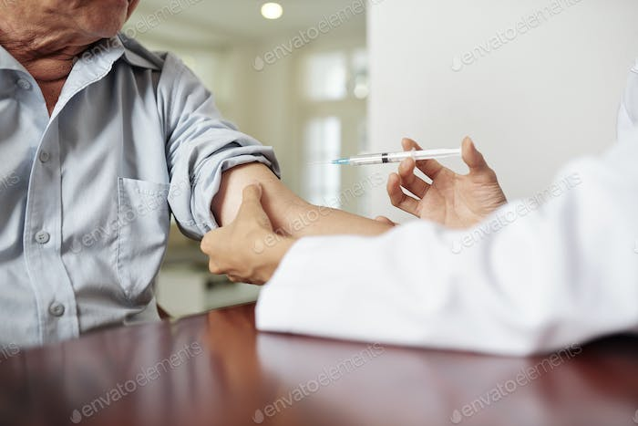 Doctor injecting the patient