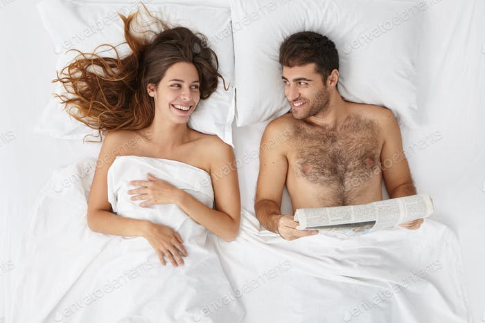 People, love, relationships, leisure, bedtime and happiness concept. Top view of happy young married