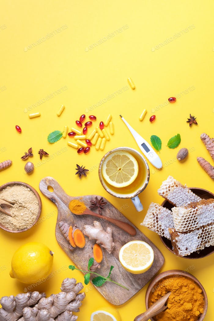 Healthcare, flu and cold treatment. Naturopathy concept. Ginger, lemon, honey, pills, drugs