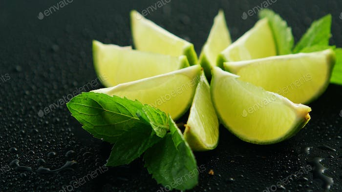 Lime segments with mint leaves