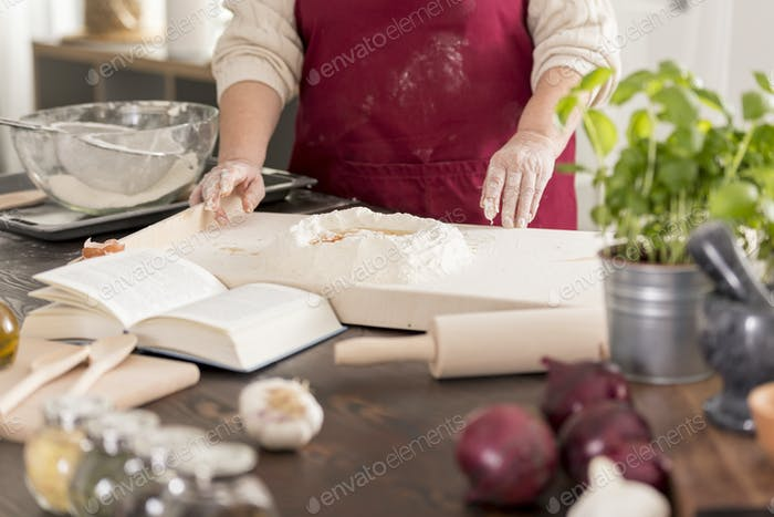 Woman preparing a dough