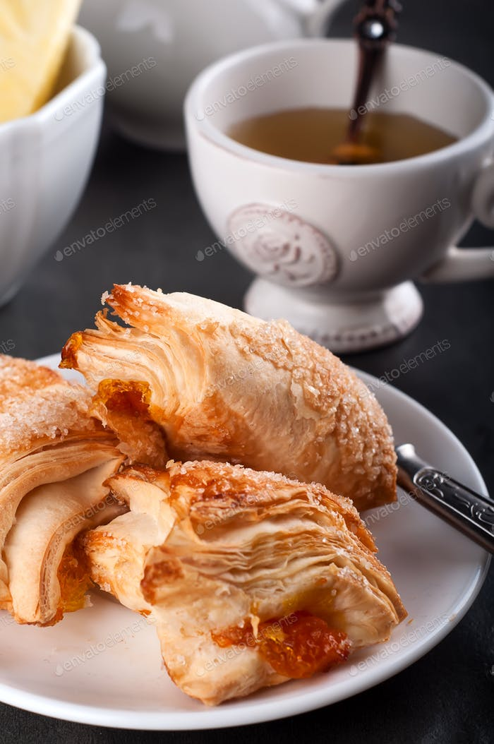 Homemade pastry with orange and Mugs of  Green Tea