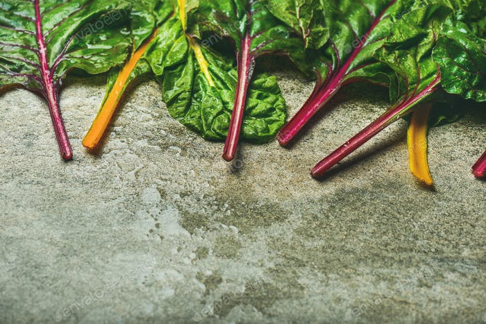 Flat-lay of fresh green leaves of swiss chard, horizontal composition