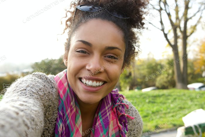 Selfie portrait of a smiling young woman