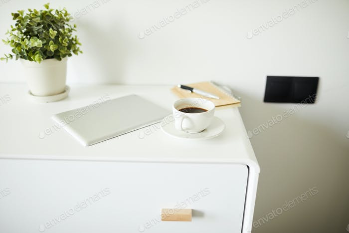 Group of stationary objects on white nightstand