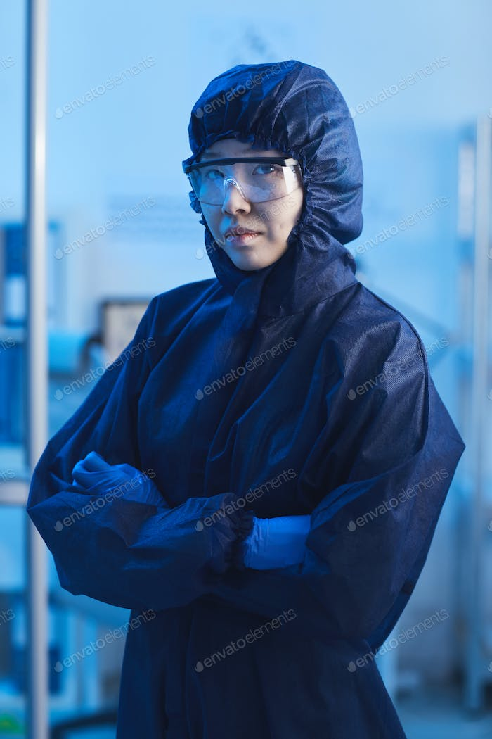 Female Chemist In Protective Suit