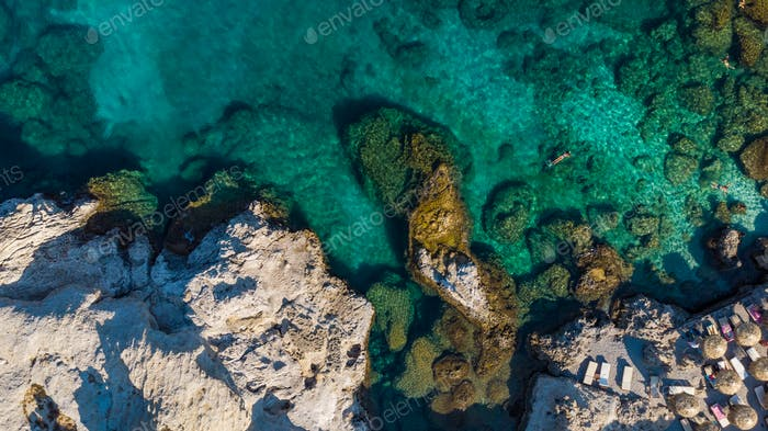Turquoise Water and Rocky Shore on Greek Island, Aerial top Down