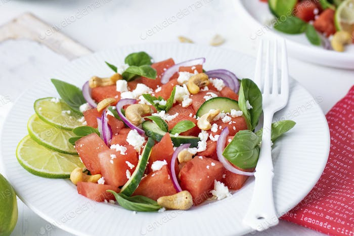Watermelon salad with basil mint red onion cucumber and cashew nuts