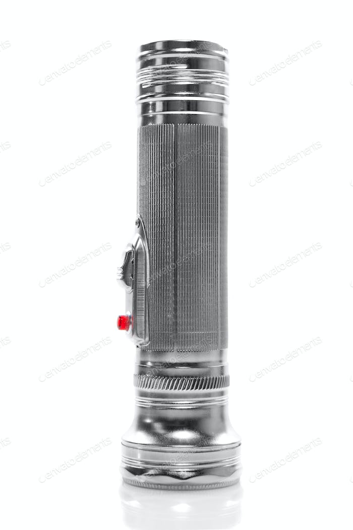 metal flashlight isolated on white