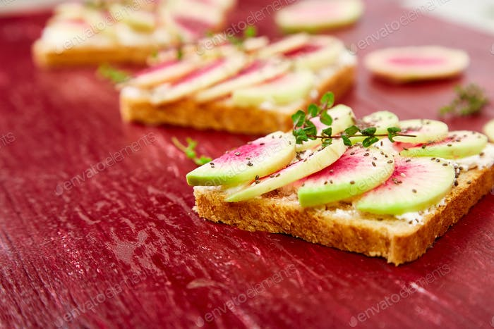 Healthy breakfast toasts from sliced watermelon radish