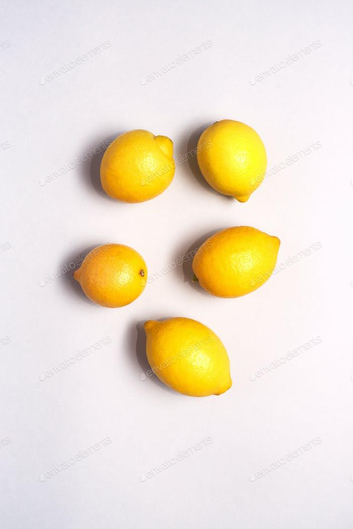 Overhead View Of  Fresh Lemons Against White Background