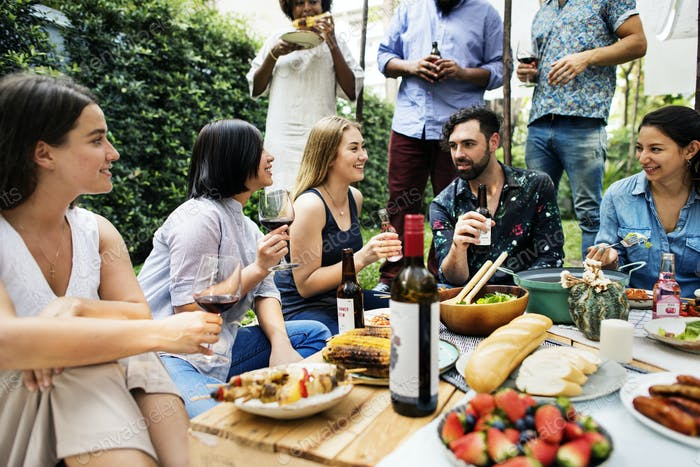 Summer party of friends in the garden