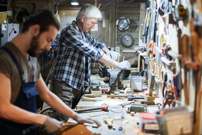 Men woodworking