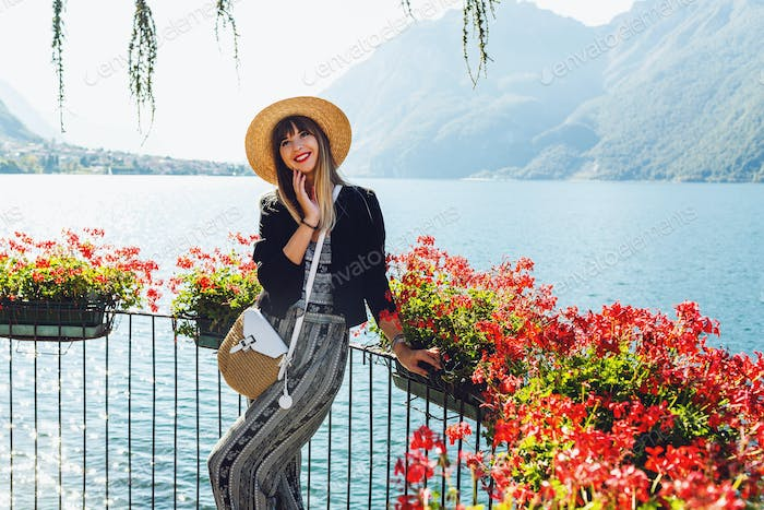 Young elegant woman in straw hat traveling