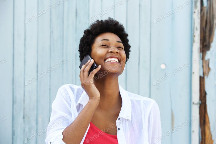 Young smiling woman talking on cell phone