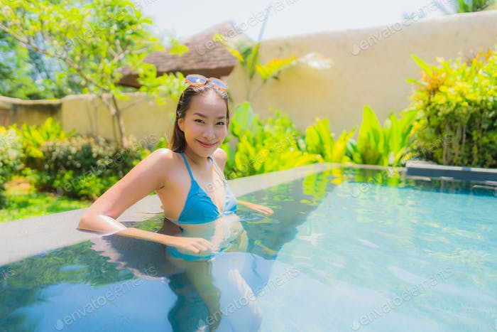 Portrait beautiful young asian woman smile happy relax and leisu