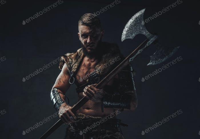 Evil legendary viking holding two handed axe in dark background